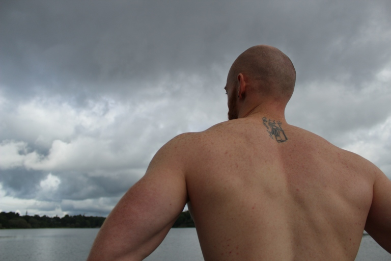 Leigh Ewin inspects the water under a threatening sky
